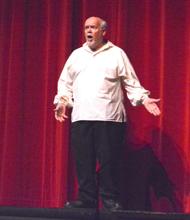 After a 31 year teaching career at Plainview High, choir director Walter Wright closes out his final year before retirement with a performance at the 2015 Red, White and Blue Revue Friday night. Photo: Doug McDonough/Plainview Herald