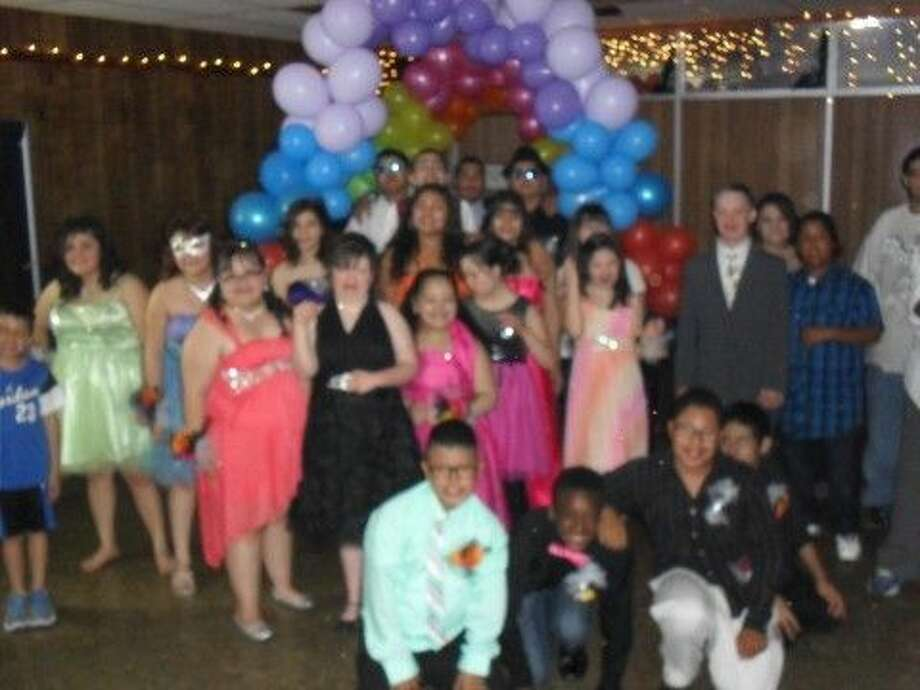Courtesy Photo Participants in this year's Candyland prom for special needs students pause during the Elks-sponsored event for a group photo.