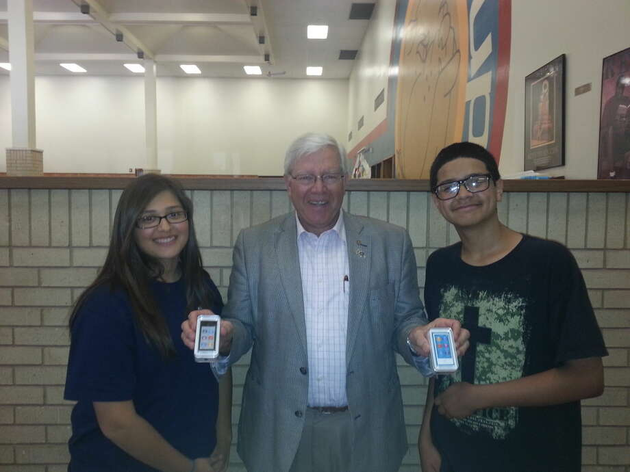 Courtesy PhotoAttendance AwardsPlainview Rotarian Charles Starnes presents iPods to Coronado Middle School perfect attendance winners Erika Raybal (left) and Nathaniel Zapata. CJHS Principal Andrew Hannon congratulated the winners and thanked them for making school an important part of their day.
