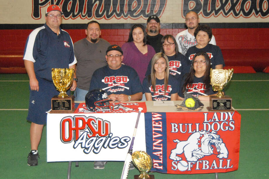Plainview's Criselda Luna (seated, center) has signed a letter of intent to play softball at Oklahoma Panhandle State. She is flanked by her parents, Richard Luna (left) and Christena Luna (right). Standing, second row from left, are PHS softball coach Johnny Hill, Criselda's uncle Gilbert Barrientos, her aunt Leticia Sanchez, her sister Shelly Luna and her grandmother Trinidad Armijo. Standing, third row, are her uncle Luis Sanchez (left) and her uncle Javier Armijo (right). Not pictured are her grandfather Luis Armijo, her grandparents Luis and Leonel and Lionila Barrientos of Harlingen, and her grandparents Max and Nora Martinez of Dimmitt. Photo: Homer Marquez/Plainview Herald