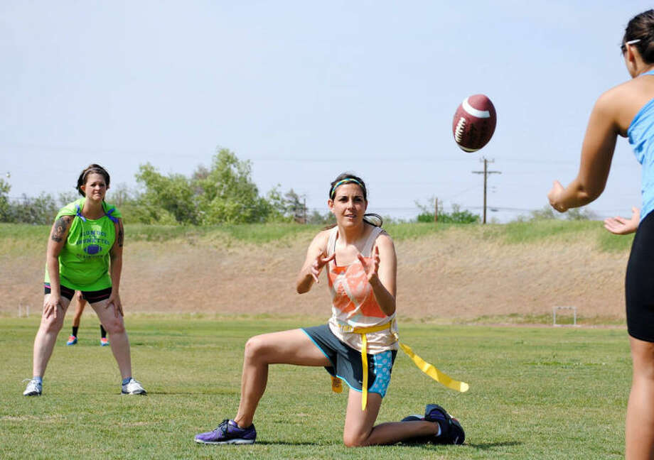 Courtesy PhotosBrunette player Rae Rousseau grabs the snap for teammate Nicole Steffe during a recent practice.
