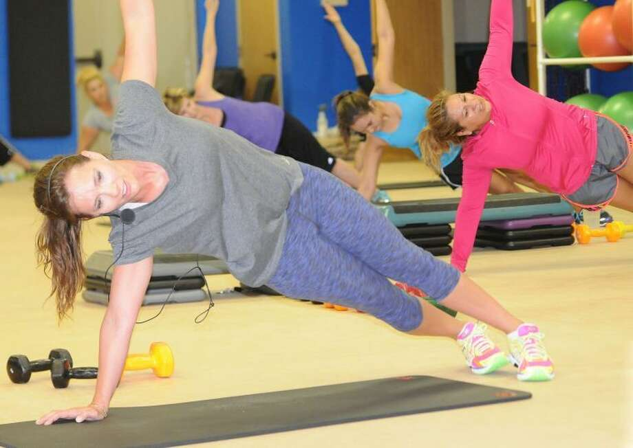 Plainview YMCA associate executive director Ashley Mayberry (front) leads her Muscle Pump class. The class is a weightlifting class for women, set to music and done in a group setting. It is one of the new offerings the Y has for those who need to either shed a few pounds or get their bodies stronger.