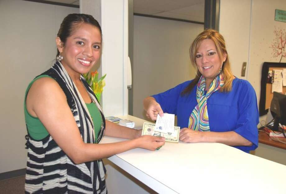 Jan Seago/Plainview ISDDeborah Alcozer (left) purchases tickets from Christina Salazar for the Hamburger Plate Fundraiser to be held 11 a.m. to 1:30 p.m. Saturday in the Greg Sherwood Memorial Bulldog Stadium parking lot. The event was organized by Houston School Principal John Gatica with all proceeds to benefit Plainview's Fourth of July Fireworks Celebration. Tickets can also be purchased at the stadium on Saturday for $5 which includes a hamburger, chips and a drink.