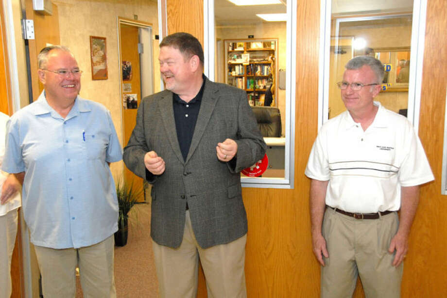 Jonathan Petty/Wayland Baptist UniversityDr. Bobby Hall (center) shares a laugh with Dr. Otto B. Schacht (left) and Dr. Barry Evans at a reception in their honor Friday morning. Schacht is stepping down as dean of the School of Business and Evans will take over that post.