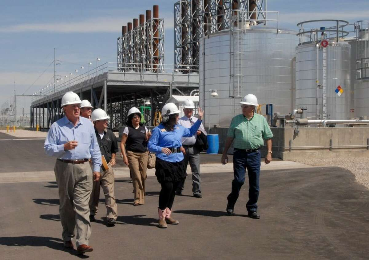 During the dedication ceremony of Antelope Station north of Abernathy, project manager Stacy Sanning (center) gives a guided tour of the facility.