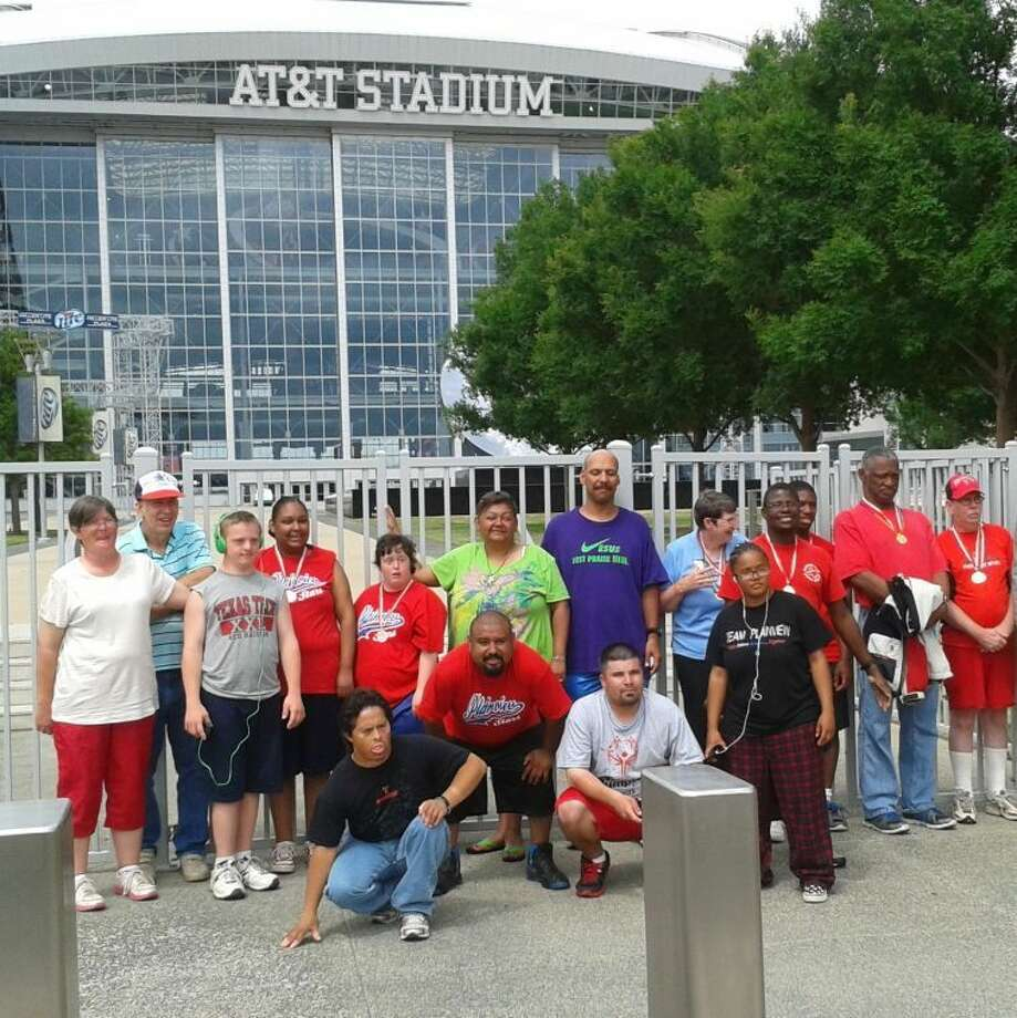 Courtesy PhotoRepresenting Plainview Stars at the State Special Olympics at the University of Texas-Arlington were Dena Nelson, coach (left); Lynn Mason, athlete/coach-in-training; Jared Ball; Donnicia Bremby; Kami Holbert; Jay Martinez, volunteer; Donnie Matsler; Diane McDonough; Polly Gomez; Danny Potts; Malachi Celestine; Jr. Hill; Ronnie Price; Raymond Quintanilla (kneeling left); Abraham Martinez; and Paul Lopez.