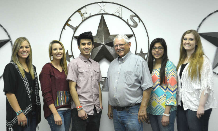 Weldon Melton, representing the Hale County Farm Bureau scholarship selection committee, congratulates this year's scholarship recipients, including Kati Adams (left), Hedley High School; Shalin Lawson, Plainview Christian High School; Eric Cervera, Plainview High School; Mariela Grimaldo, Plainview High; and Micayla Henderson, Plainview High.