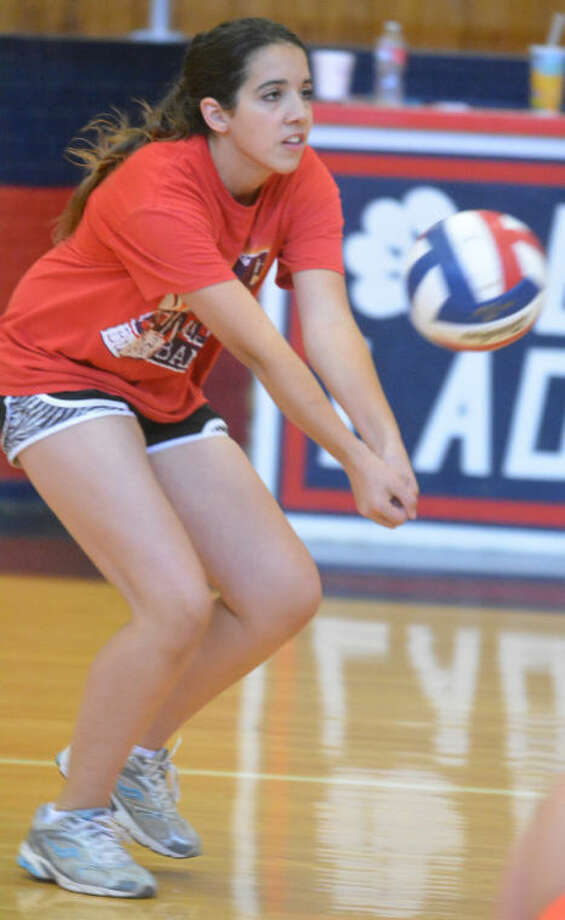 A camper passes the ball to a setter during the Plainview High School Lady Bulldog Volleyball Camp.  Photo: Skip Leon/Plainview Herald