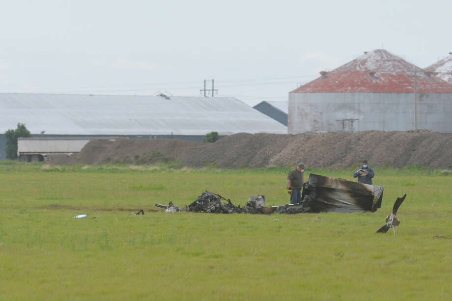 FAA officials investigate wreckage left after a plane crash Friday night at the Hale County Airport. Three were confirmed dead at the scene. Photo: Homer Marquez/Plainview Herald