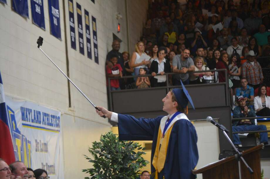 Valedictory Selfie Doug McDonough/Plainview Herald Grayson Tirey pauses to take a selfie before giving his speech as valedictorian during commencement Friday night for the Plainview High School Class of 2015. Diplomas were awarded to 327, including 257 from PHS and 70 from Houston School.