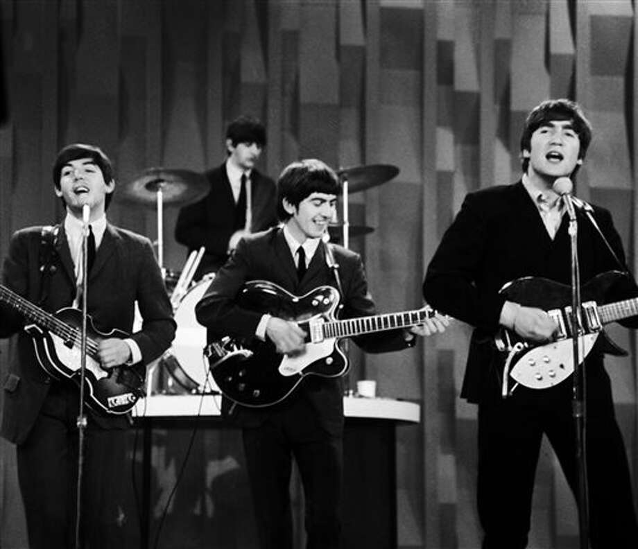 "FILE - In this Feb. 9, 1964 file photo, The Beatles , from left, Paul McCartney, Ringo Starr on drums, George Harrison and John Lennon, perform on the CBS ""Ed Sullivan Show"" in New York. The Beatles made their first appearance on ""The Ed Sullivan Show,"" America's must-see weekly variety show, on Sunday, Feb. 9, 1964. And officially kicked off Beatlemania. (AP Photo/Dan Grossi/ File) Photo: Dan Grossi / AP"