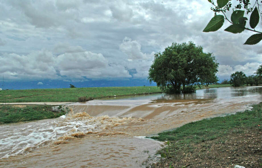 Brought on by heavy weekend precipitation, the resulting runoff cascades over Plainview's Hike and Bike Trail and into the Running Water Draw behind the old Gebo's Farm Store in the 1600 block of West Fifth. Over the weekend Plainview received 3.39 inches of rain, bringing its year-to-date total to 8.79 inches. That's more than double the 3.35 inches received over the same period in 2013. (See related photos, Page 1B.)
