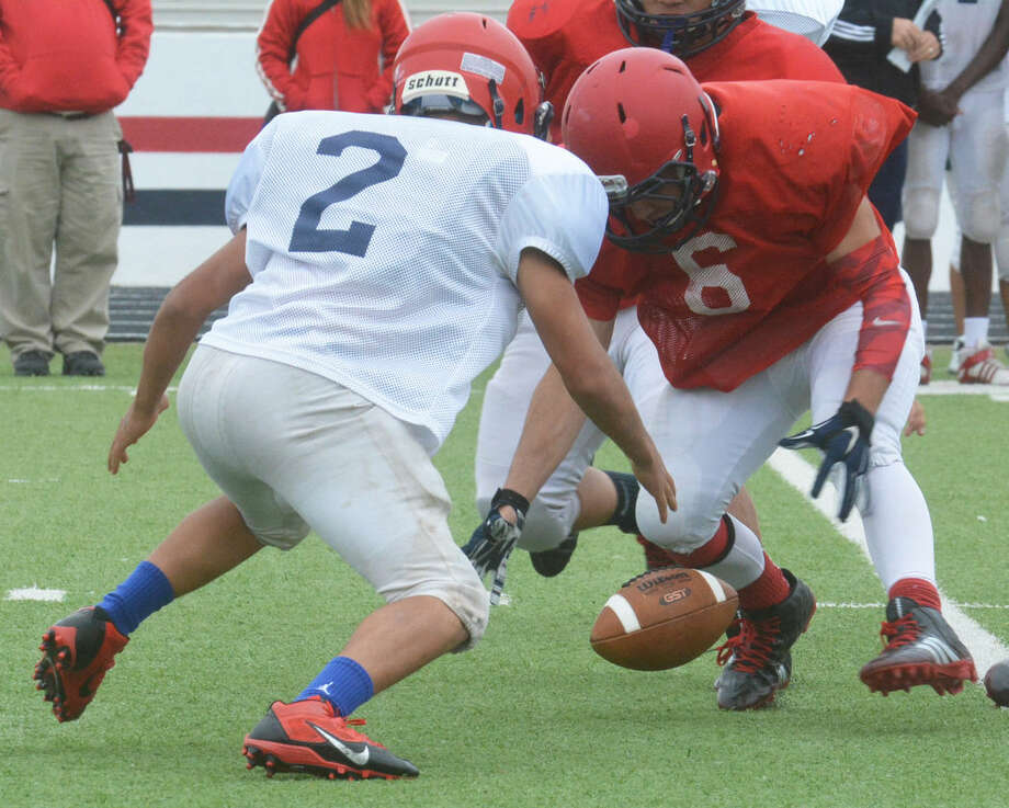 Plainview's Jerrico Enriquez (2) and Ethan Andrade (6) go after a fumble during the Bulldogs' Red/White Spring Football game recently. The team will begin fall practice Aug. 10 and will open their season at home Aug. 28 against Randall. Photo: Skip Leon/Plainview Herald