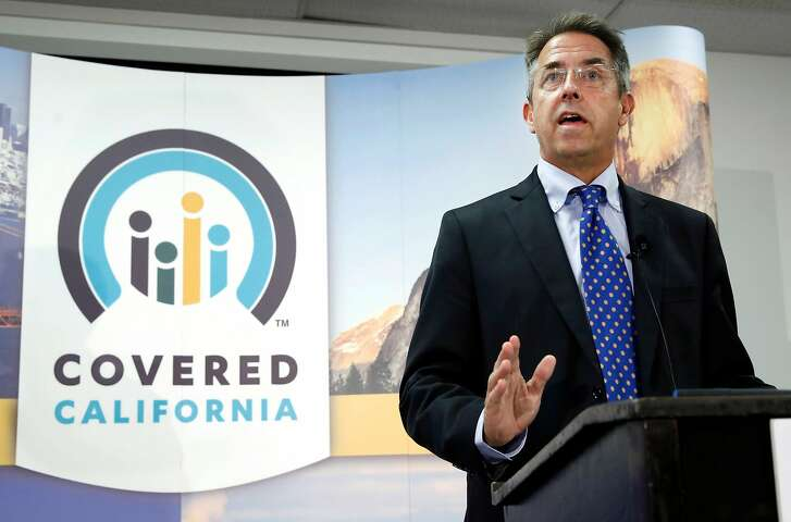 In this Nov. 13, 2013 file photo, Peter Lee, executive director of Covered California, the state's health insurance exchange, talks at a news conference in Sacramento, Calif. Long before it opened its doors to the public last fall, California's health insurance exchange awarded a small contract to a business consultant, Leesa Tori, for her advice on designing a program to sell insurance to small companies The industry veteran was a friend and former co-worker of Peter Lee, the exchange's top executive. The seemingly minor deal would mark the beginning of a lucrative and far-reaching partnership between the new state agency and the boutique consulting company Tori formed last year, just as national health care reform took root across the U.S.