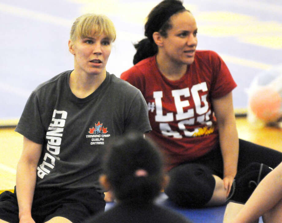U.S. Olympic Training Center resident-athletes Alyssa Lampe (left) and Kelsey Campbell are serving as clinicians at a wrestling camp at Wayland. Photo: Wayland Baptist University Photo