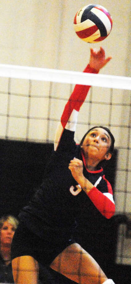 Lupita Quintanilla puts down a kill during the 2013 volleyball season. She and her friend, Taivia Hearn. will be teammates at  Western Texas College in Snyder this season. Photo: Skip Leon/Plainview Herald