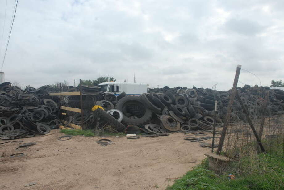 Homer MarquezMountains of more than 500,000 tires stretching across five acres at 34th Street and Wood Avenue in Seth Ward are posing a danger for neighbors.