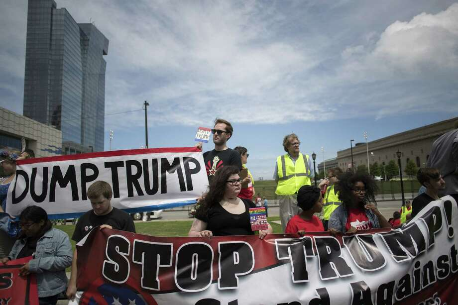"Protesters hold ""Stop Trump"" signs while demonstrating in Cleveland, Ohio. Photo: Victor J. Blue / © 2016 Bloomberg Finance LP"