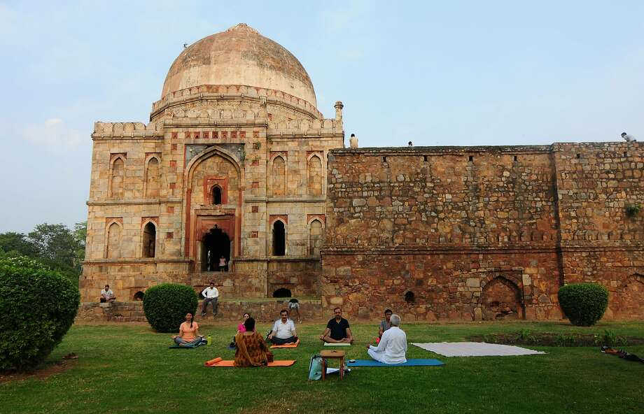 Clockwise from top: Humayun's Tomb, where the second Mughal emperor is buried. People participate in International Yoga Day, June 21, at Lodi Gardens. Street food on Mirza Ghalib Street at Hazrat Nizamuddin Basti. Photo: The India Today Group, India Today Group/Getty Images