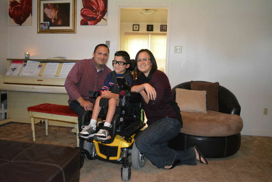 Isaac Hernandez is joined by parents Jerry and Denise just before riding out in his new motorized wheelchair donated by the Plainview Elks' Lodge. Photo: Homer Marquez/Plainview Herald