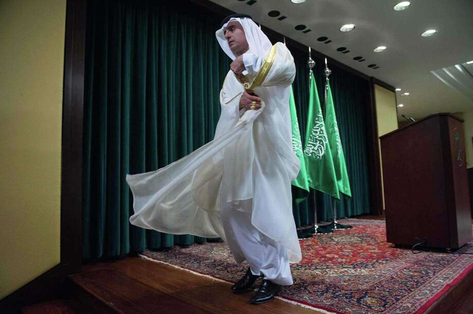 Saudi Foreign Minister Adel al-Jubeir leaves the stage after holding a news conference following the release of 28 pages of a 9/11 congressional report. The U.S. probed links between the government of Saudi Arabia and the 9/11 attacks, finding multiple suspicions but no proven ties, documents declassified on last week show. Photo: Nicholas Kamm /AFP / Getty Images / AFP or licensors