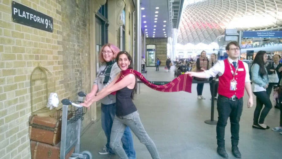 Wayland Baptist University PhotoWayland student Bridget O'Connell (background) and her cousin, Allison Sundaram, who lives in London, stand at Platform 9¾ at King's Cross Station. The fictitious platform was made famous in J.K. Rowling's Harry Potter books.