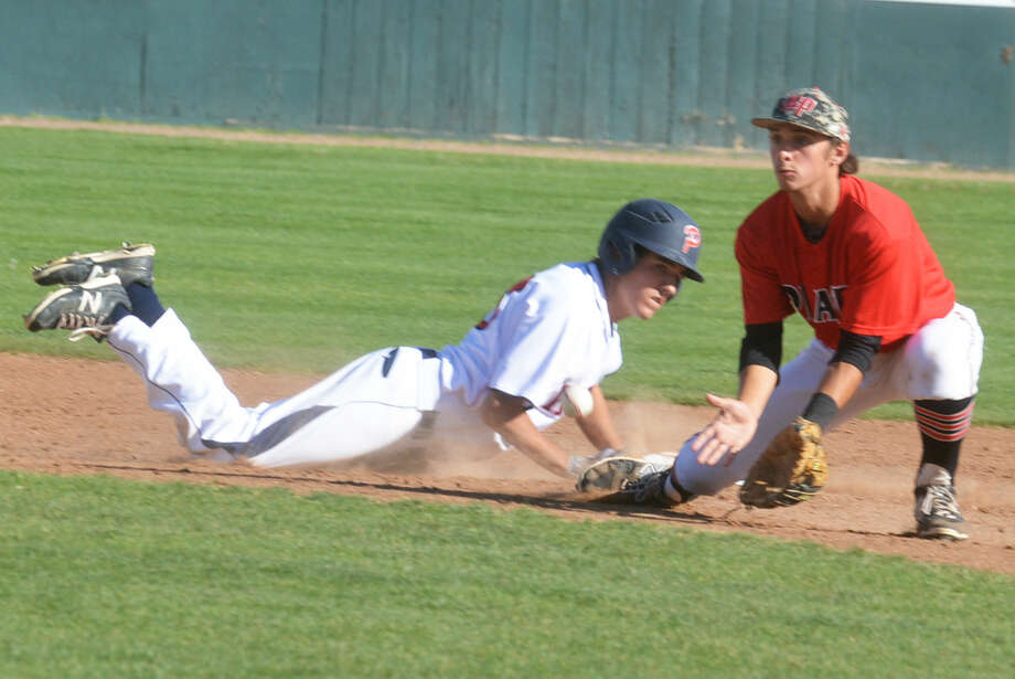 Plainview's Drew Wilkinson dives back to second base ahead of a pickoff attempt. Wilkinson was named THSCA Class 5A first team academic all-state. Photo: Skip Leon/Plainview Herald