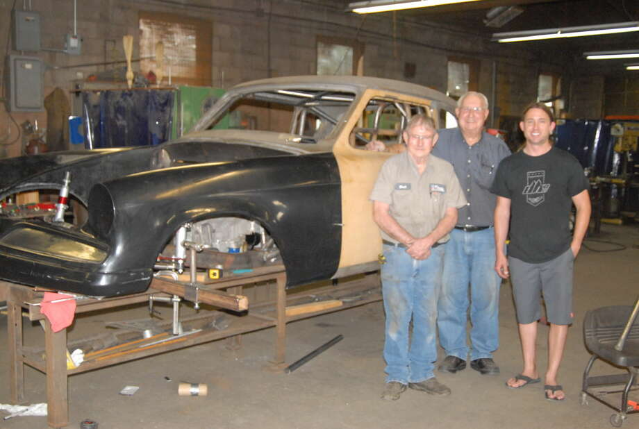 Race Car builders, Mack Fowler, who has worked at the Don Hardy garage since 1968, Don Hardy and son Donald Hardy, stand next to the modified 1953 Studebaker Hardy hopes will break a land speed record in Bonneville, Utah, in August. Photo: Homer Marquez/Plainview Herald