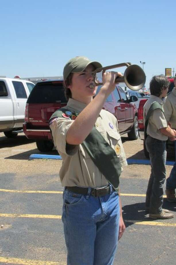 """Jana Cannon/Plainview Elks Lodge #1175Boy Scout Ben Bozeman plays """"Taps"""" on Saturday during a flag retirement ceremony hosted by the Plainview Elks Lodge."""