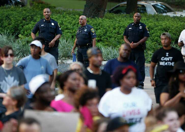 Houston police officers observe a Black Lives Matter rally that began at Discovery Green earlier this month.