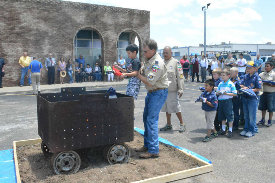 Flag retirementDoug McDonough/Plainview HeraldPack 252 Cubmaster Carl Savage lifts one of his Cub Scouts to drop a tattered American flag into an incinerator while other Scouts await their turn on Sunday during a special Flag Retirement Day hosted by Plainview Elks Lodge No. 1175. A longstanding Elk tradition, the organization held a moving Flag Day Tribute following the retirement ceremony, which included representatives from the Plainview High Naval Junior ROTC, American Legion, American Legion Auxiliary, Girl Scouts, Boy Scouts, Cub Scouts and Mary McCoy Baines Chapter of the Daughters of the American Revolution. A bagpiper, Joshua Chappell of Floydada, added to the tributes for the retired flags. Gebo's and Tractor Supply helped with the collection of flags ready for retirement.