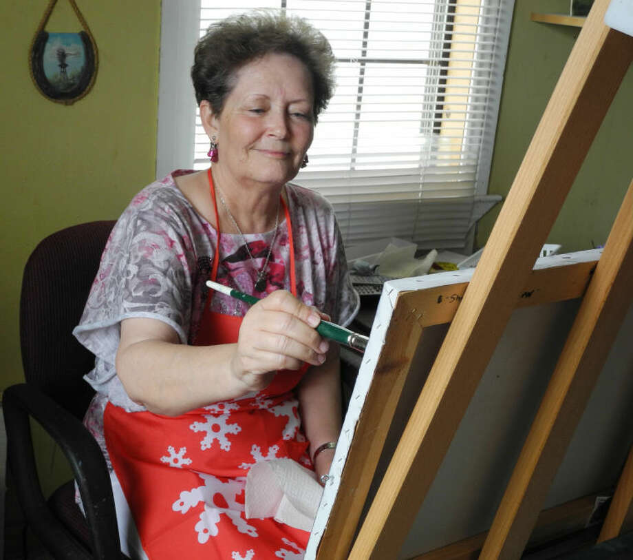 Carolyn Brain, first place winner in the oils category at Plainview Art Association's 53rd Spring Show, has been painting since 1986. Painting helps her find peace and healing from depression. Photo: Gail M. Williams | Plainview Herald