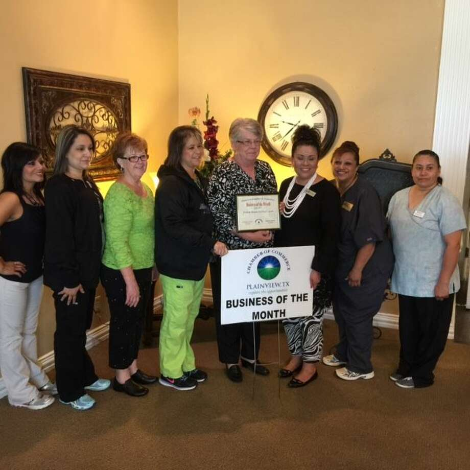 Prairie House Living Center, 1301 Mesa Dr., was recognized Tuesday as the Chamber of Commerce Business of the Month. Shown with Prairie House's administrator, Georgiana Forman Roller, LNHA, are the various department supervisors.