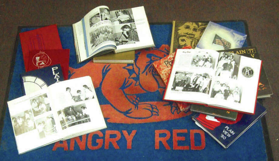 MEMORIES: Vintage Plainview High School yearbooks will help rekindle memories this weekend for the All School Reunion. PHS Plain View annuals from the Herald's collection are shown with another piece of PHS memorabilia — an Angry Red doormat from the Greg Sherwood era of Bulldog football.