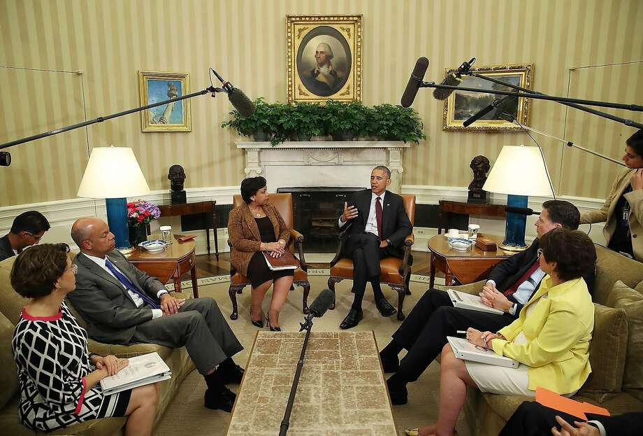President Obama (center), surrounded by some Cabinet members and advisers in the Oval Office, speaks to the media this month about the killings of officers in Dallas and Baton Rouge, La., taking the high road with reassuring rhetoric. Photo: Mark Wilson, Getty Images