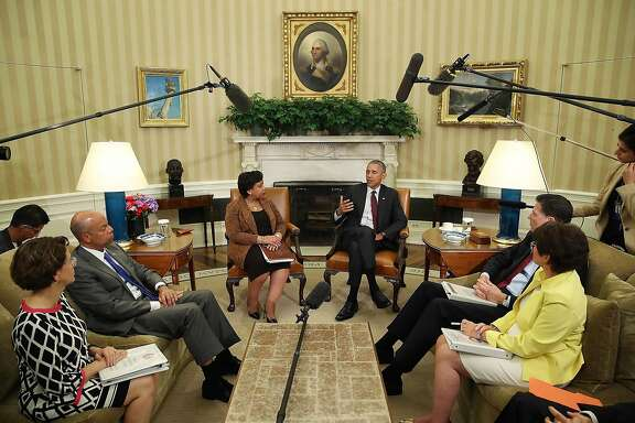 WASHINGTON, DC - JULY 19:  U.S. President Barack Obama (C) speaks to the media as (L-R) White House Domestic Policy Council Cecilia Munoz, Homeland Security Secretary Jeh Johnson, Attorney General Loretta Lynch, FBI Director James Comey and senior advisor Valerie Jarrett listen in the Oval Office at the White House July 19, 2016 in Washington, DC. The president was briefed  following the July 7 sniper killings of five Dallas police officers working a protest and Sunday's killing of three police officers in Baton Rouge, Louisiana.  (Photo by Mark Wilson/Getty Images)