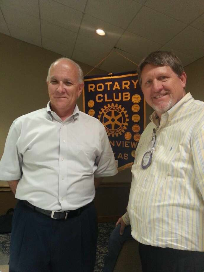 Rotary Club member David Kopp (left) introduces Kreigh Volkenaar, marketing director for Transportation Technology Services, who spoke to the club on Tuesday.