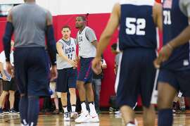 Golden State Warriors teammates Klay Thompson, left, and Kevin Durant high five during Team USA basketball practice in Las Vegas on Monday, July 18, 2016. (Benjamin Hager/Las Vegas Review-Journal via AP)