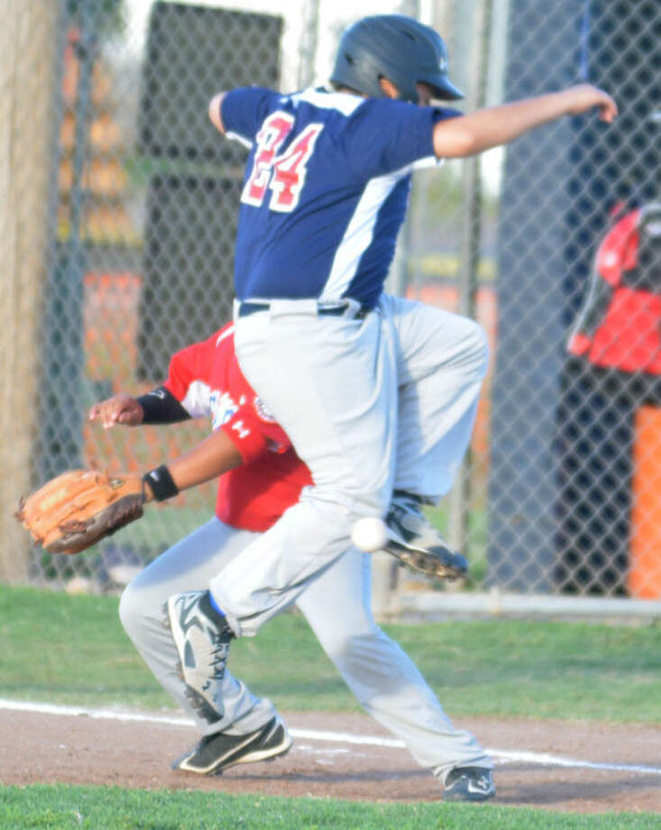 Plainview Blue's Nate Gonzales leaps to avoid a wild pickoff throw in the third inning Tuesday. Photo: Skip Leon/Plainview Herald