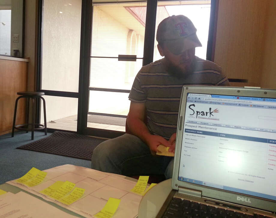 An unidentified client gets a helping hand in formulating a business model at Spark Business Accelerator. The business incubator, sponsored by Wayland Baptist University, is open to anyone who has a business idea and needs help in getting it off the ground.
