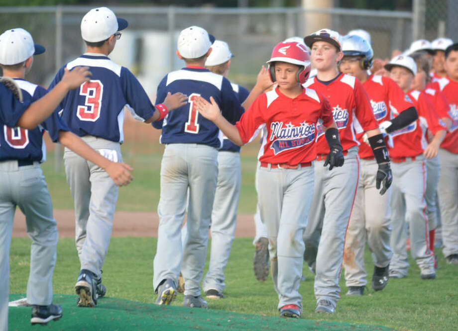 Players from the two Plainview all-star baseball teams line up and shake hands after the 11-12-year-old 70-foot district championship at McMillan Field Tuesday night. Both Plainview teams gave a good account of themselves during the tourney. Photo: Skip Leon/Plainview Herald