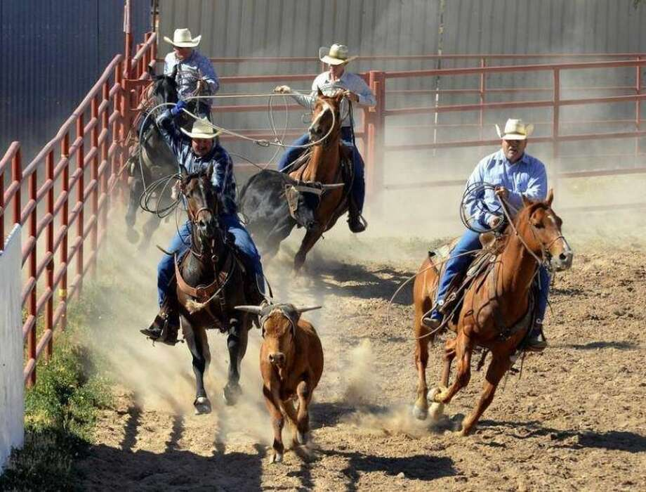 Rodeo teams compete at the inaugural Jess Dale Wyatt Memorial Rodeo June 1, 2013, in the Bar-None Arena Photo: Sam Cravey/Photo