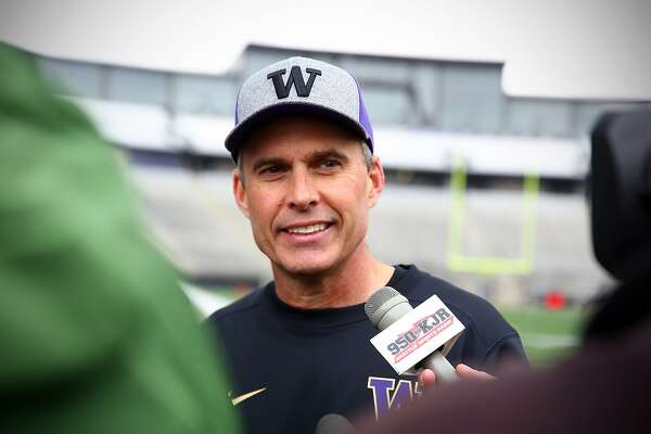 University of Washington head coach Chris Petersen is interviewed following the team's first spring practice of the year, Monday, Mar. 28, 2016. (Genna Martin, seattlepi.com)