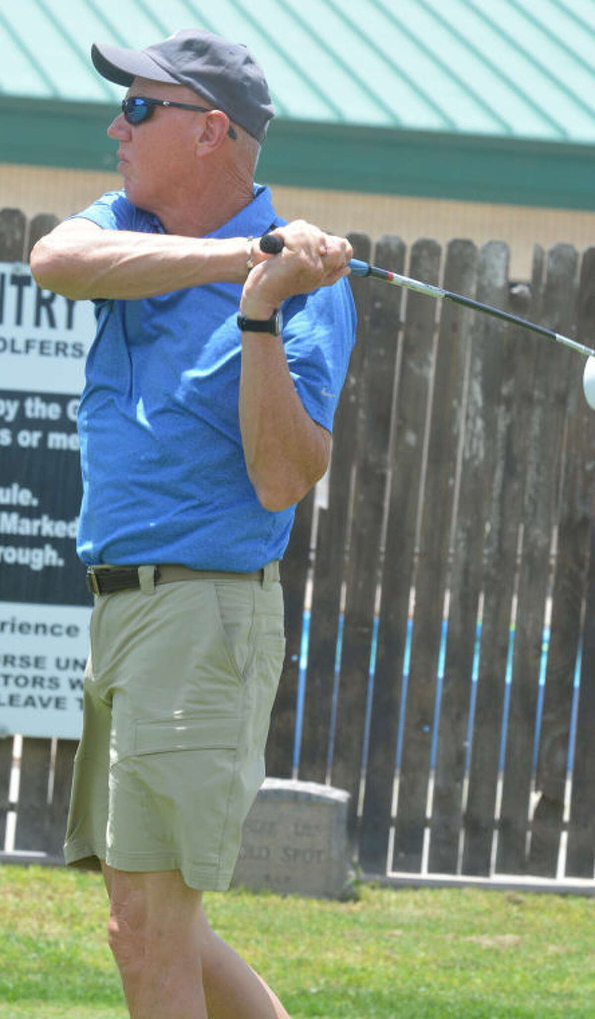 Chris Scott tees off on No. 1 during the first round of the Jack Williams Invitational Golf Tournament at Plainview Country Club Friday. Scott and his teammate, Kevin Parker, carded a 71 to lead the fourth flight by two strokes after the opening round. The tournament continued Saturday and will conclude on Sunday.