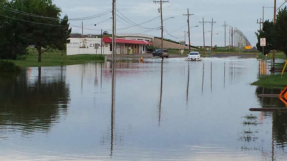 Charles Lawson/Plainview Herald In water this weekend along West 24th Street from Edgemere Drive to the east service road caused perilous driving for most vehicles. The roadway was never closed, although TxDOT put out warning signs and barricades to discourage travel.