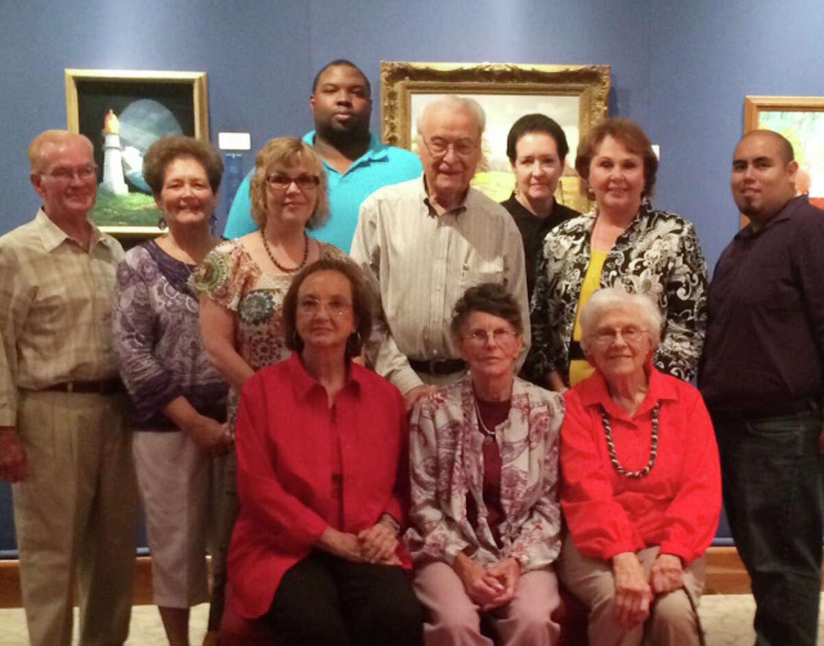 Standing: Joe Provence (left), Carolyn Brain, Joni Mayhew, Jay Coleman, Ray Freeman, Harriet Feagan and David Mancilla. Seated: Jo Goen (left), Iva Salinas and Marguerite Butler.