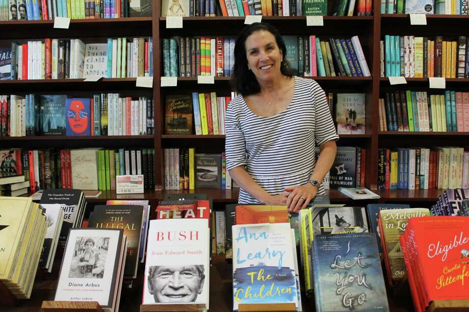 Kathleen Millard, general manager of Elm Street Books, has been managing the store for ten years. Photo: Erin Kayata / Hearst Connecticut Media / New Canaan News
