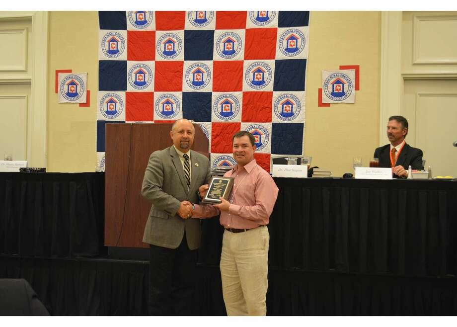 State Rep. Ken King (right) receives the Life Membership and Distinguished Service Award from Texas Rural Education Association President Dr. Shaun Barnett.