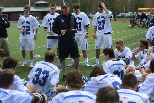 Darien High School's Boys Lacrosse coach Jeff Brameier talks to his team at halftime during their game against Wilton High School on Saturday, April 22, 2016, at Darien High School in Darien, Conn.