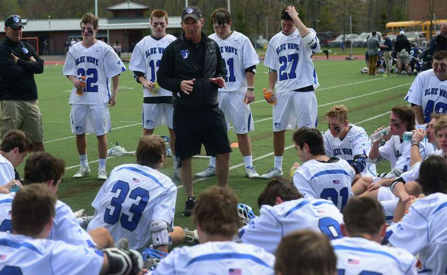 Darien High School's Boys Lacrosse coach Jeff Brameier talks to his team at halftime during their game against Wilton High School on Saturday, April 22, 2016, at Darien High School in Darien, Conn. Photo: Erik Trautmann / Hearst Connecticut Media / (C)2016, The Connecicut Post, all rights reserved